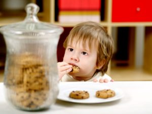 Young boy stealing cookies