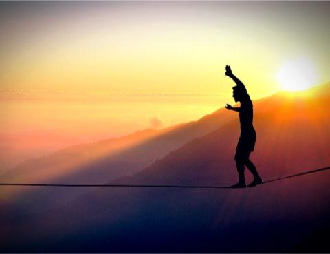 Man balancing on tightrope