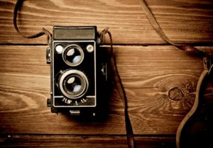 Vintage camera on wooden table
