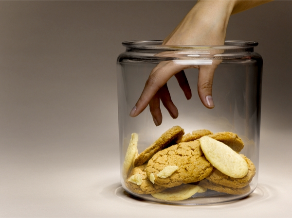 Hand reaching into cookie jar