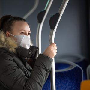Woman wearing mask on bus
